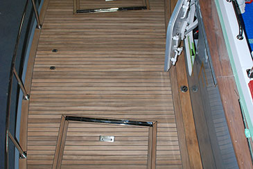 Hand laid teak deck on a new transom platform - Hunt 72