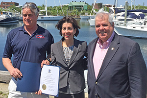 Accepting award from Gov. Gina Raimondo with Portsmouth Senator Jim Seveney