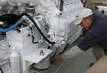 NEB's head electrician Buzz Flanders confirms installation details of the twin MAN 1550 HP - 12 cylinder, turbocharged diesels.
